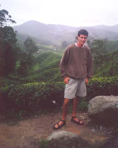 John with the Boh tea plantation in the background